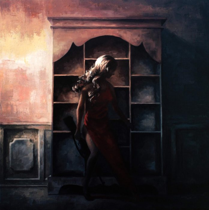 Woman in darkness holding a gun in front of shelves
