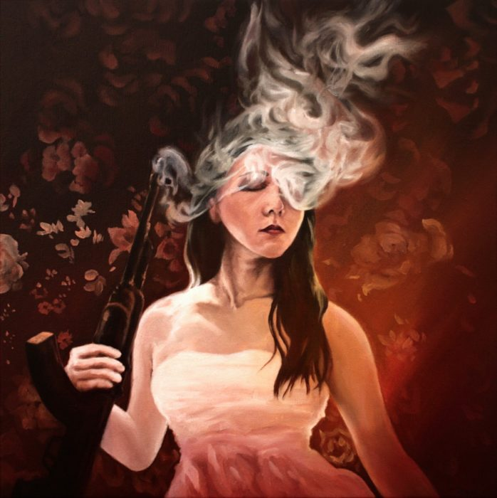 woman-holding-a-smoking-ak47-with-flora-background