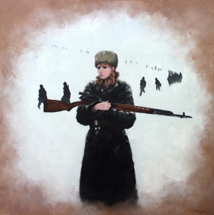 Russian woman partisan holding a sniper rifle in the snow