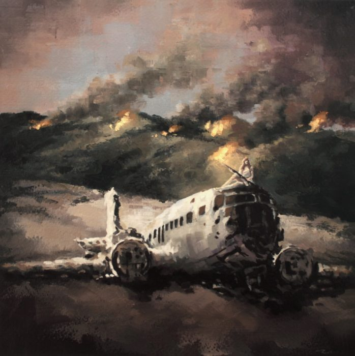 Woman holding a rifle sitting on a crached airplane in burning mountains